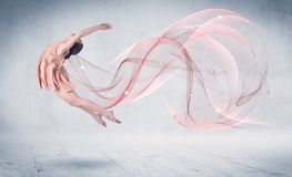 Dancing ballet performance artist with abstract swirl royalty free stock photos
