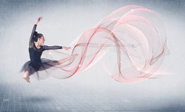 Dancing ballet performance artist with abstract swirl royalty free stock images
