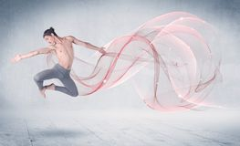 Dancing ballet performance artist with abstract swirl royalty free stock photo