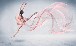 Dancing ballet performance artist with abstract swirl. Concept on background royalty free stock photography