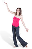 Dancing barefooted young woman. In blue jeans and red blouse royalty free stock images