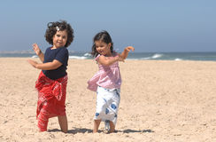 Dancing on the beach. Cute little girls dancing on the beach Royalty Free Stock Images
