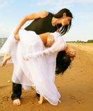 Dancing on the beach Royalty Free Stock Image