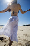 Dancing on the beach. A beautiful young brunette woman dances on the beach royalty free stock photos
