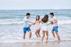 Dancing on the beach stock photo