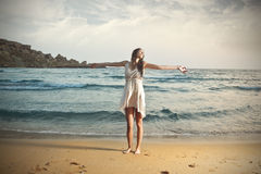Dancing at the beach royalty free stock photography