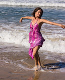 Dancing on the beach of Goa. A beautiful young woman is dancing on the Beach of Candolim, Goa, India Royalty Free Stock Image