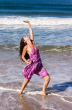 Dancing on the beach of Goa. A beautiful young woman is dancing on the Beach of Candolim, Goa, India Stock Image