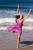 Dancing on the beach of Goa. A beautiful young woman is dancing on the Beach of Candolim, Goa, India Stock Images