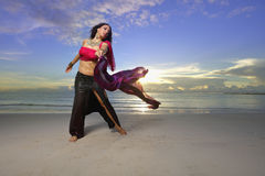 Dancing on the beach at sunrise Royalty Free Stock Images