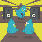 Dancing birds. The bird sings into the microphone. Disco with karaoke. Stock Image