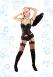 Dancing black lingerie angel with pink hair and sn Stock Images