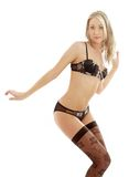 Dancing blond in brown lingerie Stock Photo