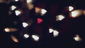 Dancing blurred hearts, bokeh, red heart in the middle