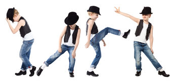 Dancing boy isolated on white. Little boy in jeance and hat is dancing on white Royalty Free Stock Images