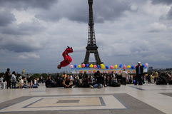 Dancing boy play in front of eiffel tower Stock Photos