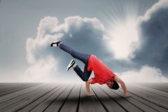 Dancing boy under clouds Royalty Free Stock Photos