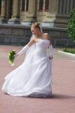 Dancing bride. Near the theatre Stock Photos