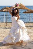 Dancing bride with wedding bouquet Stock Photo