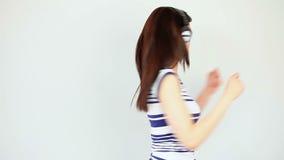 Dancing brunette listening to music stock video