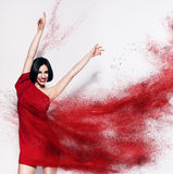 Dancing brunette woman in red powder Royalty Free Stock Photo