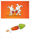 Dancing bunnies and carrots. Two white rabbit dance, sliced carrots Royalty Free Stock Images