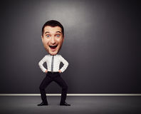 Dancing businessman with big head Stock Photography
