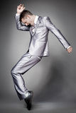 Dancing  businessman in elegant gray suit. Royalty Free Stock Photography
