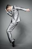 Dancing businessman in elegant gray suit. Stock Photo