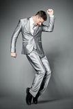 Dancing businessman in elegant gray suit. Stock Photo