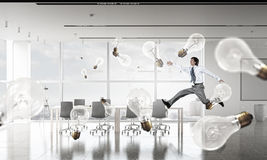 Dancing businessman in office room Royalty Free Stock Images