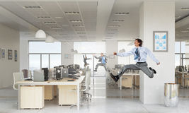 Dancing businesspeople in office room Stock Images