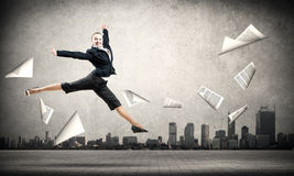 Dancing businesswoman Stock Image