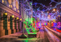 Dancing in the capital. Christmas decoration of the street in Moscow in the form of dancing people Stock Image