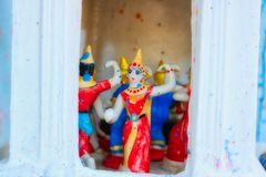 Dancing ceramic figures in a small Thai temple stock images