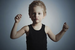 Dancing Child. Funny Little Boy.Handsome Boy try to dance. Blue background Royalty Free Stock Image