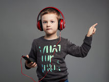 Dancing child.little boy in headphones.kid listening music. Dancing child.little boy in headphones.fashionable kid listening music Stock Image