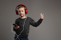 Dancing child.little boy in headphones.kid listening music. Dancing child.little boy in headphones.fashionable kid listening music Stock Photography