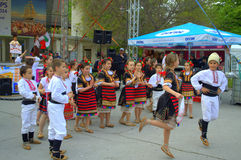 Dancing children. Children Folklore dance with  at outdoor culture event .Picture taken on May 1st,2014 at  Varna square,Bulgaria,Europe Stock Photography