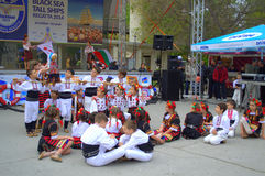 Dancing children. Children Folklore dance with ribbons  at street culture event .Picture taken on May 1st,2014 at  Varna square,Bulgaria,Europe Stock Photos