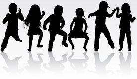 Dancing children silhouettes. Happy girls and boys Stock Photography