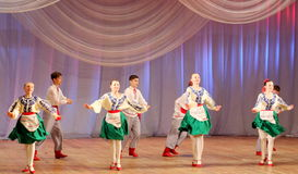 Dancing children in traditional costumes Stock Images