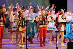 Dancing children in traditional costumes. Speech by the dance group Soniah on the stage of the Kyiv Palace of children and youth. Yuileyny concert dedicated to Royalty Free Stock Photos