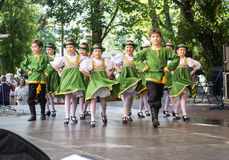 Dancing childrens in national costumes. RIGA, LATVIA - JULY 03:  Dancing childrens in national costumes at the Latvian National Song and Dance Festival on July Stock Image