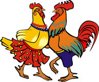 Dancing Cock. Cock and hen clad in traditional clothes performing a folk dance Royalty Free Stock Photo