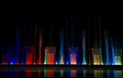 Dancing colorful fountain Stock Images