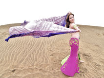 Dancing with a colour cloth at the desert Royalty Free Stock Photo