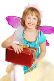 Dancing costume girl with present. Little dencing   girl in fairy costume with big red present  on white background Royalty Free Stock Photos