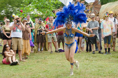 Dancing at the Country Fair. A woman in an outrageious costume dances for a happy audience at the Oregon Country Fair outside of Eugene, Oregon royalty free stock images