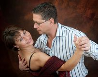 Dancing couple. Attractive couple dancing the night away Royalty Free Stock Images